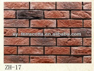 Uomo fatto piastrelle decorative a parete finto muro di mattoni